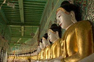 A row of Buddhas © Carole Scott 2013