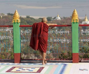 A monk enjoys the view © Carole Scott 2013