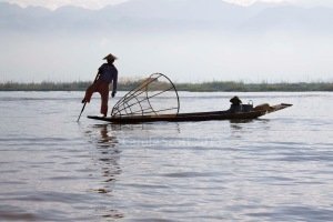 The unique rowing style of the Inle Lake fishermen